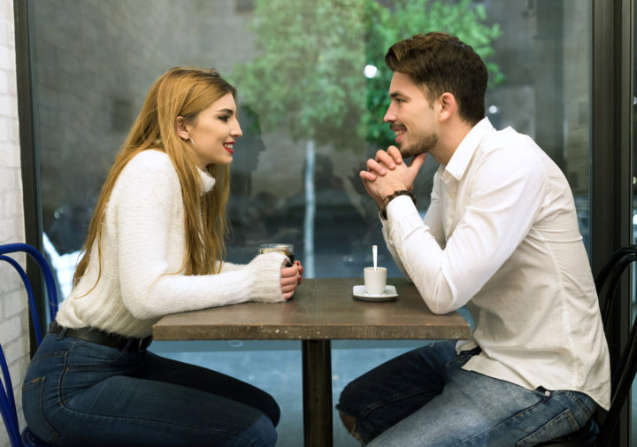Beautiful young couple in love at a coffee shop.