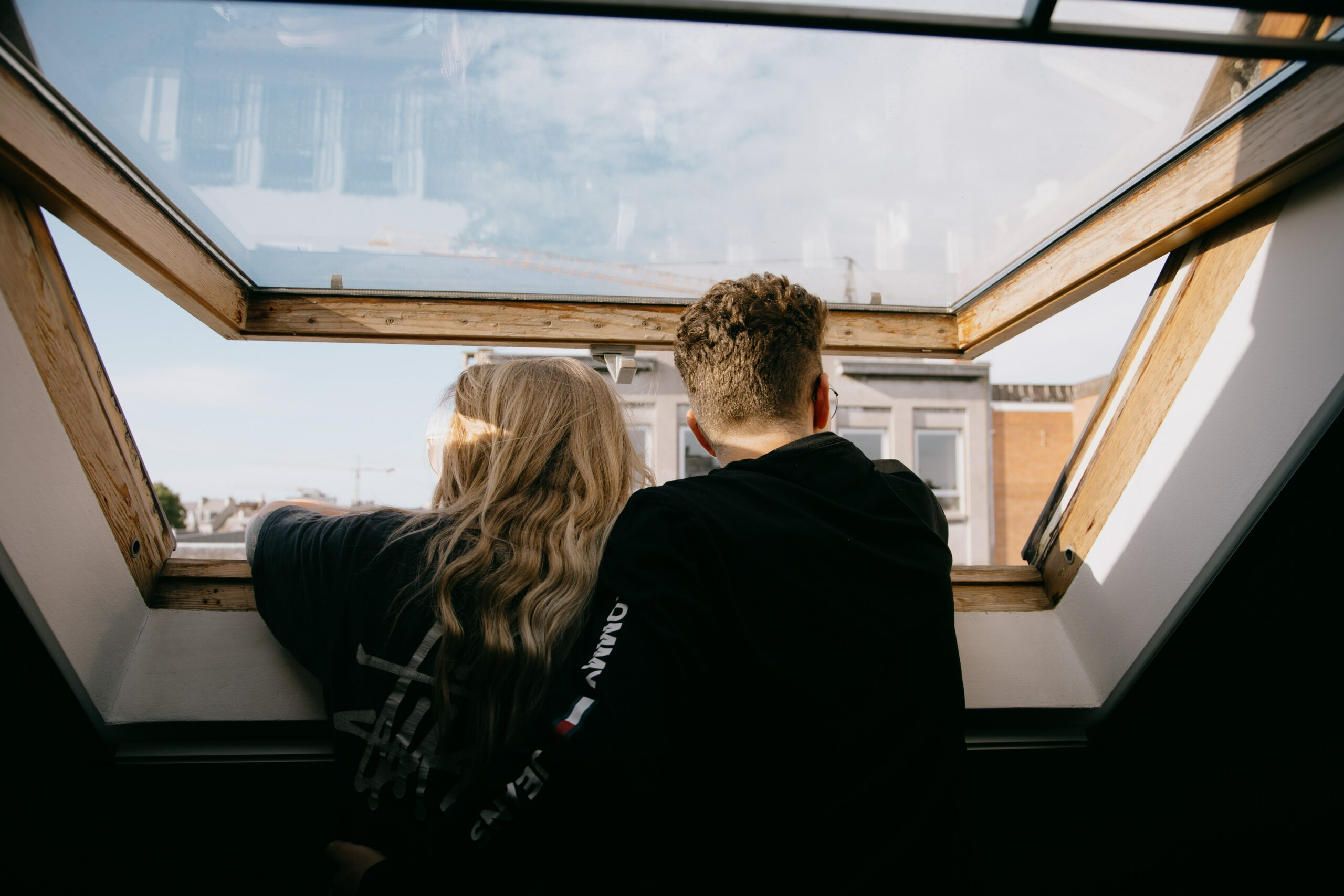 a couple looking outside of the window_sexual attraction_better sex_tickle.life